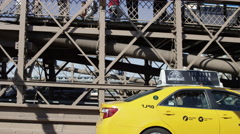 taxi cab on Brooklyn Bridge with view of Manhattan Bridge cars traffic in 4K NYC - stock footage