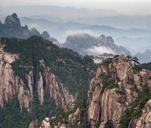 Huangshan mountain and Chinese house at cloudy weather - stock photo