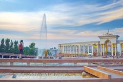 Young tourist on the fountain in National Park, Almaty Stock Photos