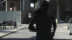 silhouette athlete female running jogging Brooklyn New York City slow motion 4K - stock footage