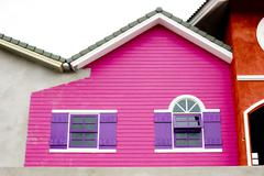 Colorful house, pink and violet color of wood house. - stock photo