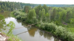 Suspended Bridge. The river Serga, Russia. 1280x720 Stock Footage