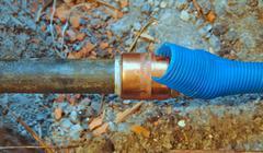 Cold water pipe on broken floor Stock Photos