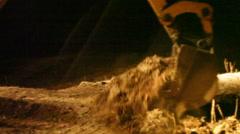 Bulldozer digging at night in the dark, work around the clock, medium shot Stock Footage