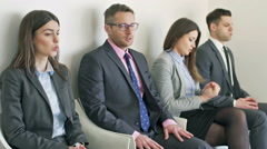 Nervous businesspeople waiting for interview Stock Footage