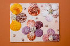 The Tropical photo frame with seashells background - stock photo