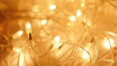 Warm yellow Christmas decorative glittering lights  with one bulb focused Ful Stock Footage