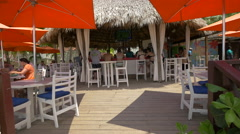 Relaxing and having drinks at the snack bar in Montego Bay, Jamaica Stock Footage