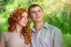 Dreamy couple in the park - stock photo