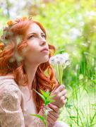 Dreamy woman with dandelions - stock photo