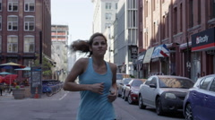 Citi Bikes Empire State Building woman jogging blue tank top Brooklyn slow 4K NY Stock Footage
