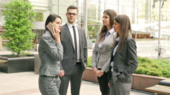 Happy businesspeople standing and talking on cellphone Stock Footage