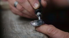 Goldsmith Polishing Silver Rring with Grinder Stock Footage