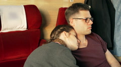 Couple traveling and sleeping in the train, steadycam shot - stock footage