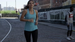 athlete training Brooklyn female jogger running blue tank top 4K slow motion NYC - stock footage