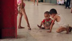 Homeless children play on the dirty station. - stock footage