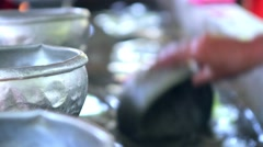 Monks wash dishes after dinner. Stock Footage