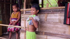 Children living in the jungle. Shy kids. Bamboo huts. Stock Footage