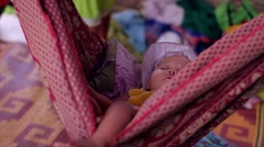 Baby sleeps in a hammock in a bamboo hut. Stock Footage