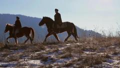 Jockeys on horses go to the mountains. Mountain people. Stock Footage