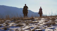 Close-up of mountain riders. Highlands. Stock Footage
