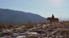 Two border guards on horses during the winter. Sunny winter day. Stock Footage