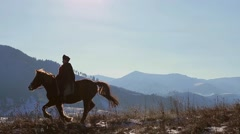 Competition on horseback in the mountains. Stock Footage