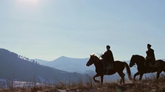 Running horses on the evening hills. Warm winter evening. Stock Footage