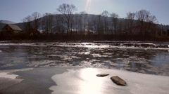 Landscape winter river. Ice melts. Sunny weather. Mountain locality. Stock Footage