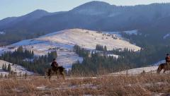 Horse Racing on a background of mountain panorama. Stock Footage