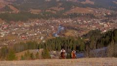 Riders climb the mountain. Beautiful panorama of the city. Stock Footage