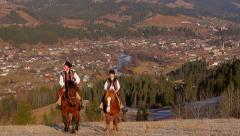 Horses climb the mountain. Panorama of a mountain locality. Stock Footage