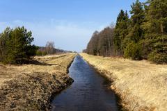 small rural river - stock photo