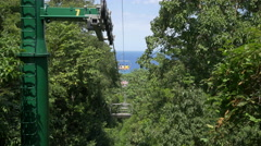 Chairlift rides in the forest of Jamaica Stock Footage