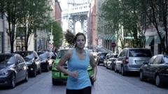 Woman running street Brooklyn Bridge green taxi background slow motion 4K NYC Stock Footage