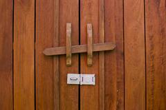 Obsolete wooden door bolt, Thai tradition - stock photo