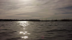 Slow motion waves on vuoksa lake in sunset light Stock Footage