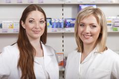 Two druggists in drugstore Stock Photos