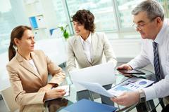 Discussing business matters - stock photo