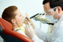 Teeth examination Stock Photos