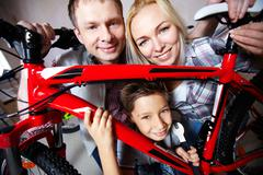 Family with mountain bike - stock photo