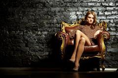 Female in armchair - stock photo