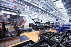 Auto body on conveyor line at car plant Stock Photos