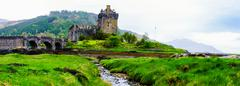 Panoramic view of famous Eilean Donan Castle in Scotland, UK Stock Photos
