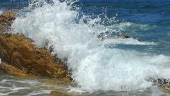 Wave splashing rocks coast sea spray foam Stock Footage