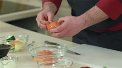 Chef peeling tomatoes after soaking them into the hot water. Close-up - stock footage