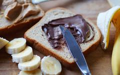 Peanut butter and chocolate spread sandwich - stock photo