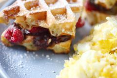 Fruit and chocolate waffles with eggs - stock photo