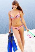 Diver in bikini - stock photo