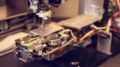 Sewing machine inside tight shot Stock Footage